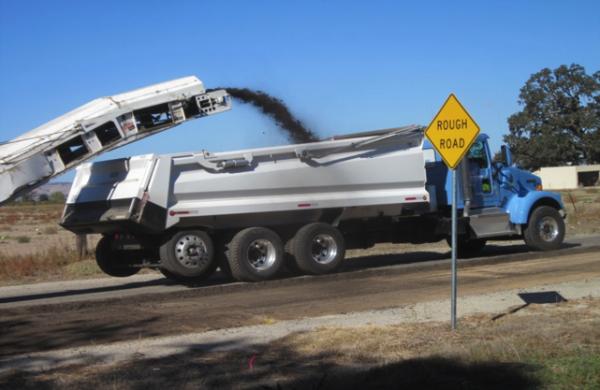 Contractor removing old asphalt