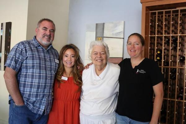 Mark McConnell (Broker/Owner), Liz Lee (Broker/Owner), Pearl Munak (Founder of Transitional Food and Shelter), Heather Mikelonis (Board of Directors of Transitional Food & Shelter)
