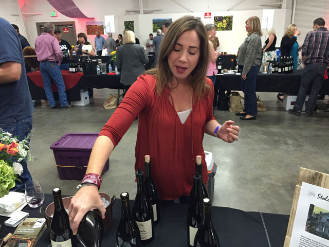 Maria Stolo Bennetti pours wine from her Stolo Family Vineyards in Cambria.