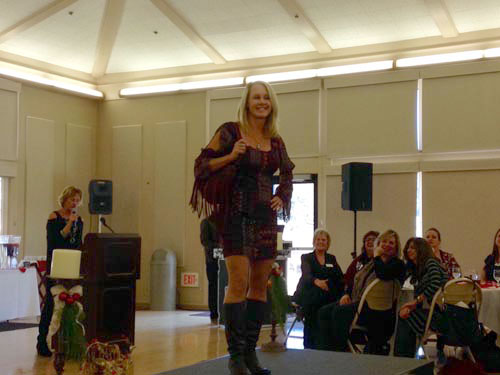 Julie Opheim modeling fashions at the Atascadero Chamber of Commerce luncheon and holiday fashion show.