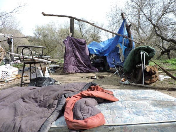 One of the estimated 40 homeless encampments in the riverbed. Photography by DuPree Dial.