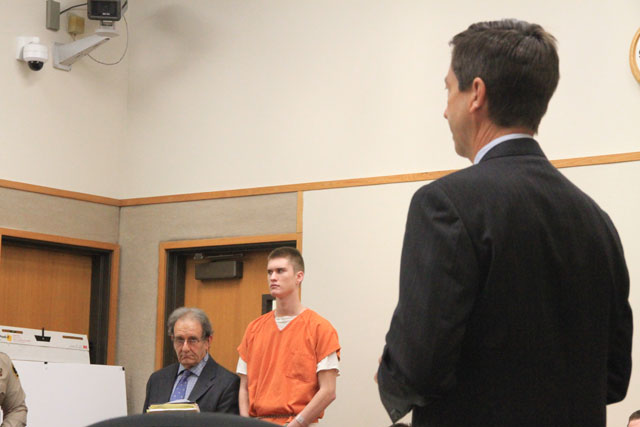 Bret Landen, center in orange, with his attorney, Jeffrey Stein, at his side. Deputy District Attorney Matt Kraut in the foreground addressing Judge John Trice on Wednesday. Photo by Heather Young