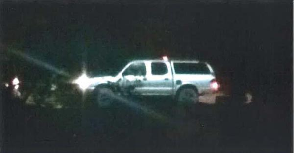 A witness was able to take a photograph of one of the vehicles leaving the area. The vehicle is a silver 2000-2004 Toyota Tacoma truck with a silver camper shell and black matte rims and tinted windows.