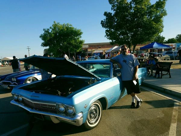 Ralph Garcia with his 1966 Chevy Impala Super Sport.