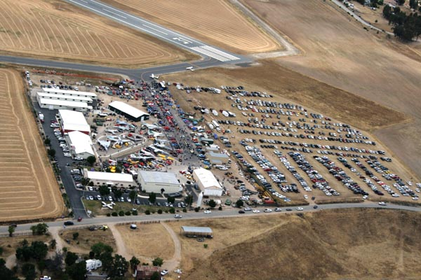 An aerial view of this year's Warbirds Wings and Wheels 8 show on Dry Creek Road where 4,000 people attended. (Steve Lochan photo).