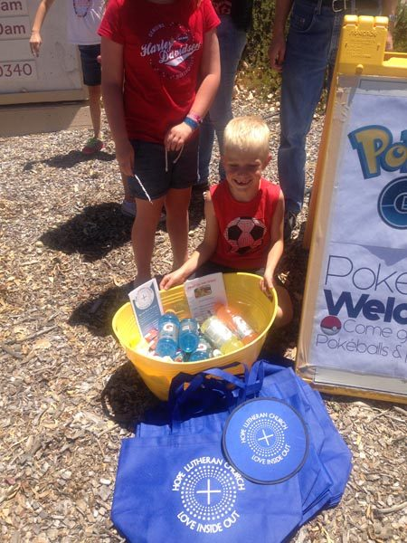 "Pastors Liz and Ryan put their heads together and decided to put a sign out in front of Hope Lutheran Church letting others know that they were a Pokestop point. ""We offer Gatorade, juice boxes, water, snacks, and even sunscreen to other players as they search out Pokemons, especially in this hot weather."""