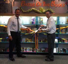 Paso Robles Joint Unified School District Superintendent Chris Williams joins Mayor Steve Martin at the Library during a ribbon-cutting ceremony to official open nearly 400 new Battle of the Books collection materials.