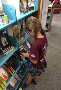 Student browses new collection of Battle of the Books titles.