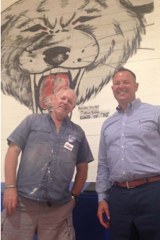 Superintendent Chris Williams and local artist and alumnus Steve Kalar.