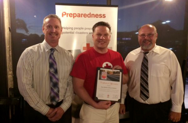 From left: Director of Student Services Paul Press, Disaster Program Manager for the Red Cross Ryan McMahon, School Safety Officer Jason Taylor.