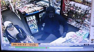 Security footage of the San Miguel gas station robbery on Nov. 6.