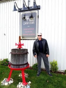 "Gary Kramer out front at his new ""Cheers""-style Guitar Cellars."