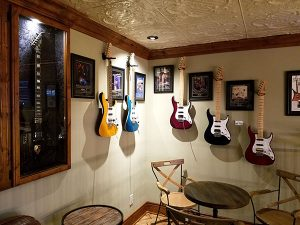 Guitar memorabilia in the second floor lounge at Gary Kramer Guitar Cellars.