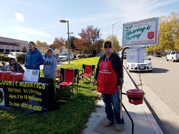 Paso Robles volunteers with North County Aquatics and the Salvation Army on the sidewalk on 6th St.