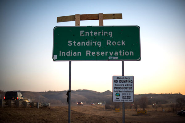 San Luis Obiso County photographer Brittany App captured the bullet-holed sign upon entering Standing Rock.