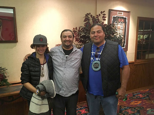 Middle-schooler Liliana Monge with her father Roberto and Myron Dewey, founder of Digital Smoke Signals.