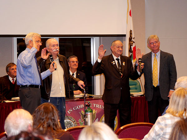 Dennis Fansler, Michael Compton, Fred Strong and Steve Gregory get sworn in (photos Jordan Elgrably).