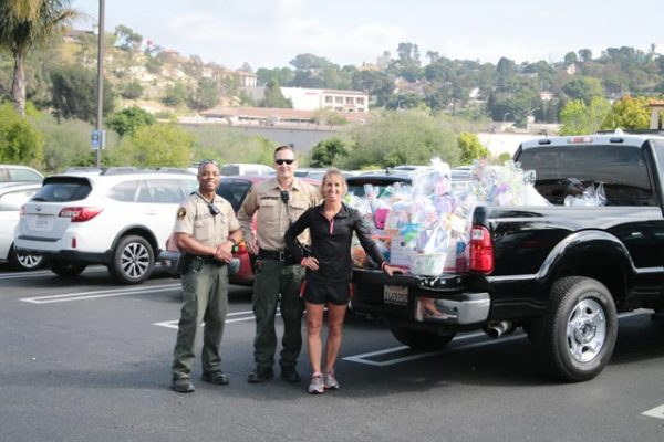 "On Wednesday, CAT Team Deputies Ron Slaughter and Toby Depew provided needed assistance to ""Baskets of Love,"" a local program developed by Joy Danley to distribute 1,000 Easter baskets to homeless children within San Luis Obispo County."