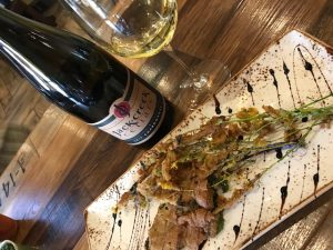 Tempura batter-fried mustard flowers with Jack Creek Cellars chardonnay