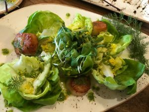 Scallop salad with chimichuri sauce made from wild plantain leaves