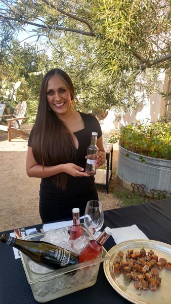 Elena Martinez offering barrel samples of Top's 2016 Rose and Poise.