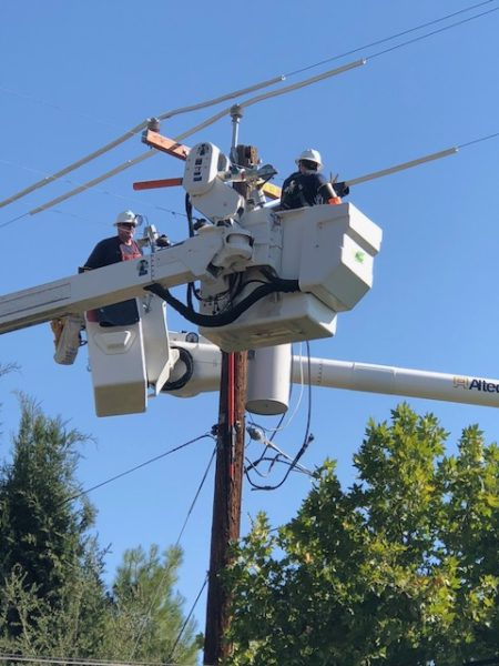 PG and E works on power lines in paso robles