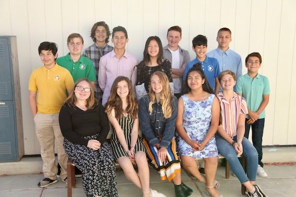 Eighth grade students graduate Almond Acres.