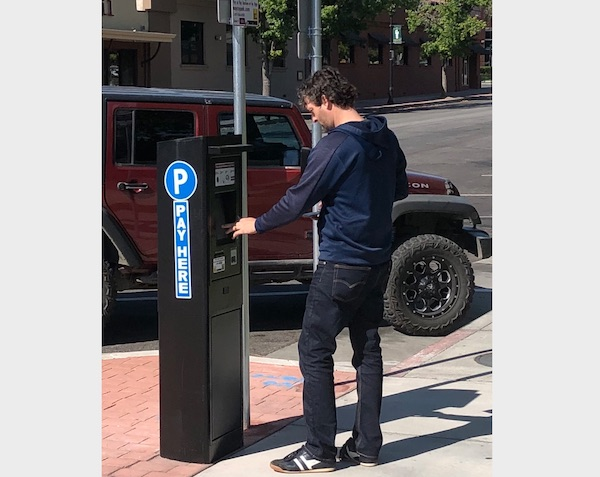 City asking community to fill our survey on new paid parking downtown