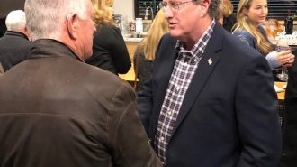 Election Caldwell shaking hands