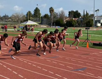 High school track and field team races at intrasquad meet