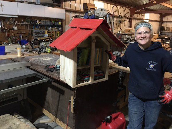 Hannah Bourgault completes a tiny library for elementary students