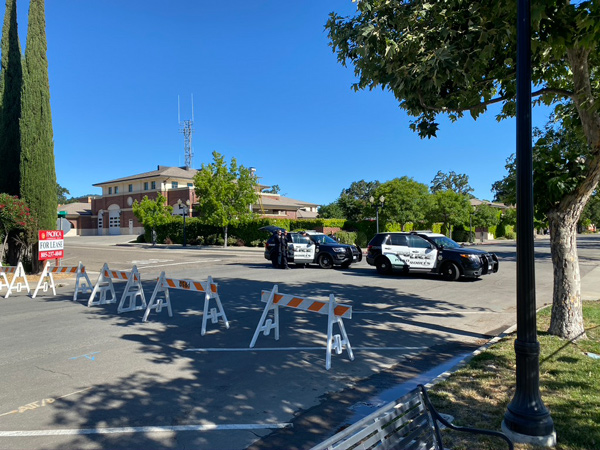 Law enforcement maintains a barricade at the corner of 9th and Pine streets Wednesday at 9 a.m.