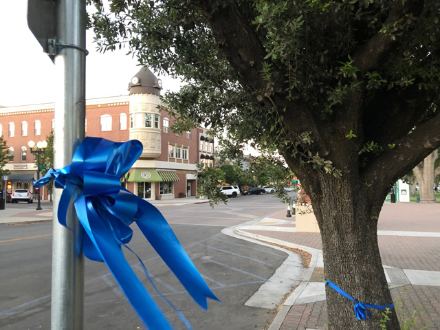 Blue ribbons were placed throughout downtown Paso Robles to honor the police officers shot in last week's manhunt and shootout.
