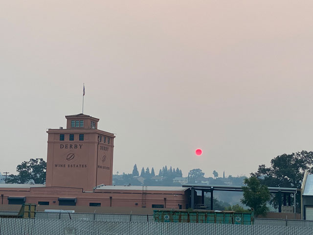 Air district issues health caution as wildfires push smoke into Valley