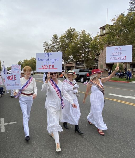 Women dressed in white portrayed suffragists on the 100th anniversary of women getting the right to vote.