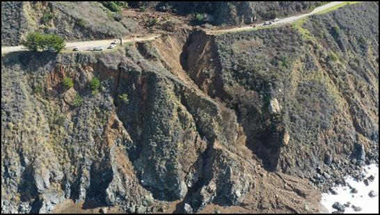 Aerial photo showing debris and the washout of Highway 1 on February 1