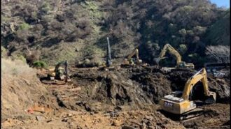 Excavators removing debris from the canyon February 11
