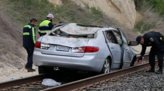 Single-vehicle collision leaves car disabled on railroad tracks, driver injured