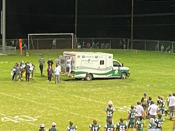 Eagles Sr Anthony Fischer loaded into ambulance