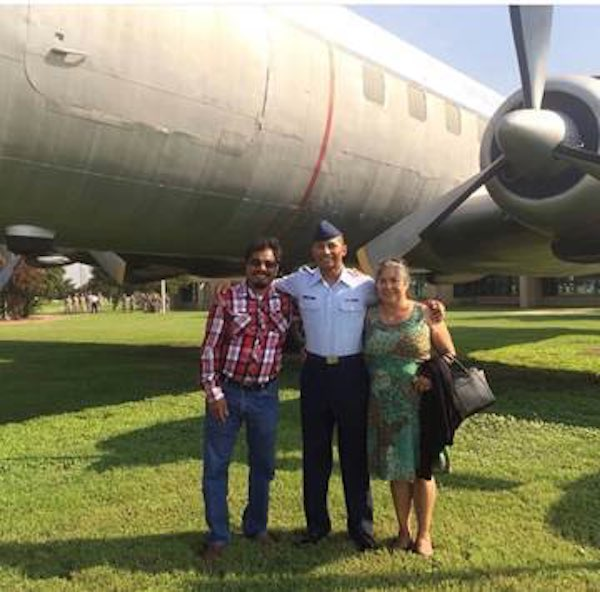 Mrs. Juana Flores and her husband with their son, Sgt. Caesar Flores of the United States Air Force