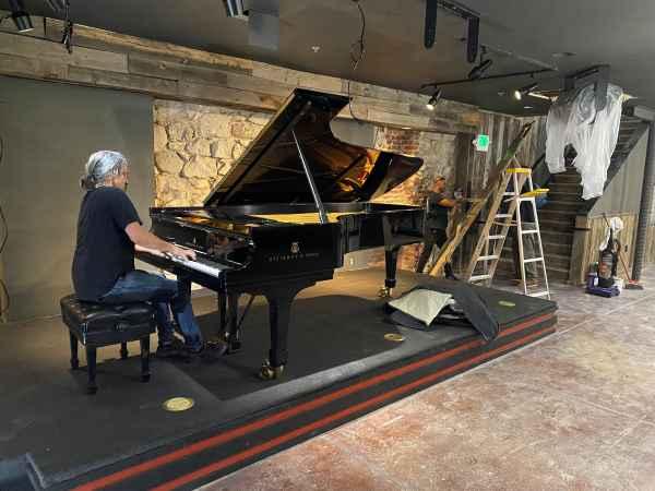 Corey at large piano playing